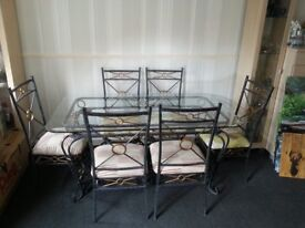 Beautiful glass top table + 8 matching chairs