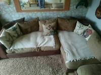 Large 4/5 seater leather and tweed corner sofa with footstool.