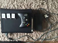 Xbox 360 in the box good condition not used for quite a while 1 controller