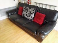 black leather sofa- very good condition