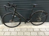 Completely New Pinacle £1000 in shop, disc brakes, carbon fork, Shimano Tiagra, mudguards, road bike