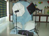 Photographer studio equipment including Bowens photographic flash and Lastolite backgrounds
