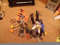 4 action men with loads of accessories boots weapons rope ladder belts clothes