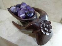Hand carved wooden hand with 10 amethyst pieces