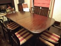 STAG MINSTREL EXTENDING DINING TABLE WITH 6 CHAIRS (Including 2 carvers)