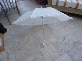 Ivory frilled wedding umbrella