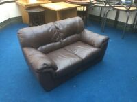 Small two seater brown leather sofa