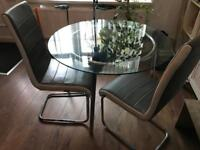 Glass dining table plus two chairs