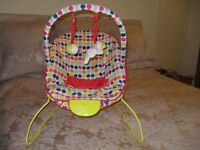 Vibrating and musical baby bouncer with toys