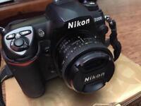 Nikon D200 DSLR camera with 50mm lens plus accessories