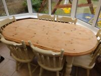 Solid oval pine dining table plus six chairs