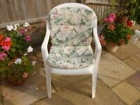 Garden chairs (x4) white plastic with floral cushions