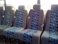 10 coach/minibus seats with headrests.