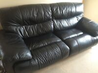 Black leather sofa and arm chair