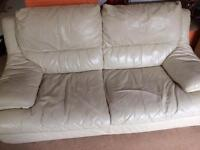 Two cream two seater Leather sofas
