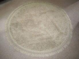 "Large circular wool rug 60"" diameter."