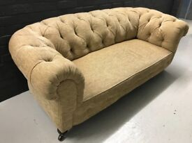 2 seater Chesterfield style sofa in good condition.