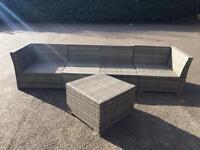 Rattan sofa with table