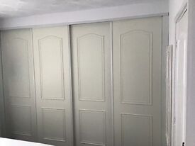 Sliding wardrobe doors with the rails can be adapted to fit a ny space up to 3 metres