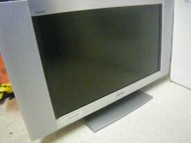"""SONY BRAVIA WEGA 32"""" LCD TV. BRUSHED SILVER. IN NEED OF REPAIR, as STUCK IN STANDBY MODE."""
