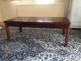 Mahogany coloured wooden coffee table.
