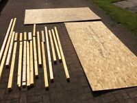 2 x 2400mm x 1200mm x 9mm thick Norbord ply sheets and various wooden posts.