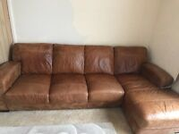 SOFA 4 SEATER LEATHER SOFA WITH SHEZLONG-LEATHER ARM CHAIR AND LEATHER PUFFY WITH STORAGE