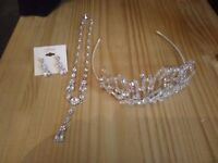 Never worn tiara, ear rings and necklace diamond