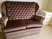 Brown two seat sofa