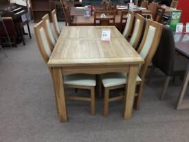 Light Wood Dining Table and 6 Cream Chairs