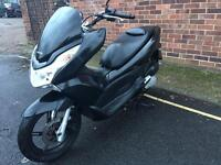 Honda PCX 125 2013 for sale £1299 no offers.