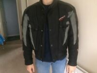 Motor bike jacket with protected elbows .