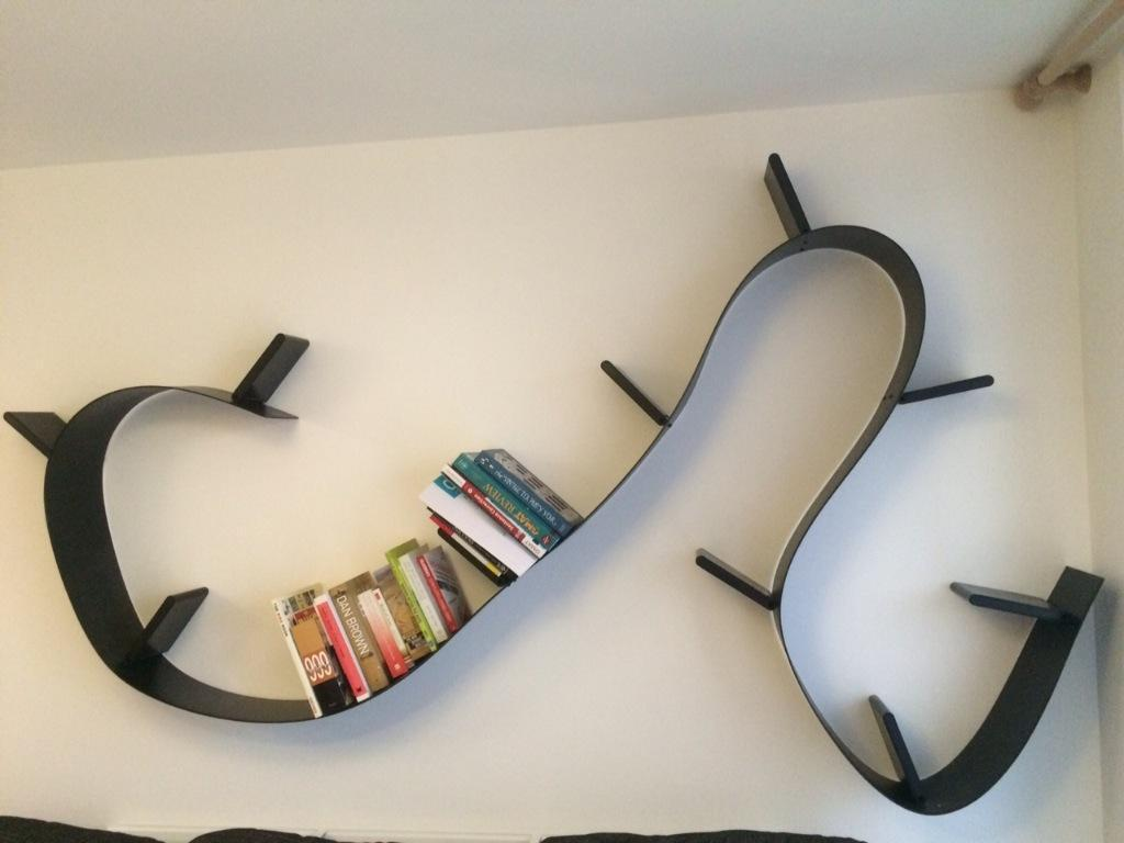 Bookworm shelf kartell by ron arad black 11 bookends for Ikea bookends uk