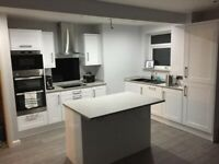 Magnet Dunham Kitchen Gloss White with Argent worktops and upstands