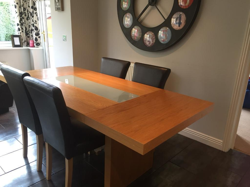 Solid oak table & 4 brown leather chairs