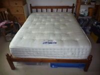 King size firm deluxe mattress and slatted pine bed frame for sale.