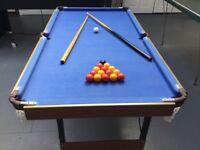 Mini pool table 141cm (L) x 74cm (W) x 81cm (h). Folding legs.