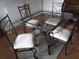 Glass top table and 4 chairs recently expensively professionally upholstered