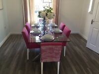 Show home glass table and 6 chairs