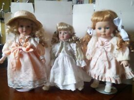 set of 3 porcelin dolls 1ft tall, immaculate condition