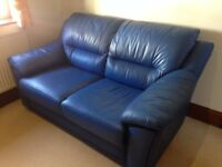 BLUE LEATHER TWO SEATER SOFA; HARDLY EVER USED