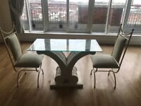 Beautifully crafted glass topped stone table and chairs