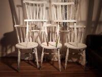 Five bespoke custom painted chairs.