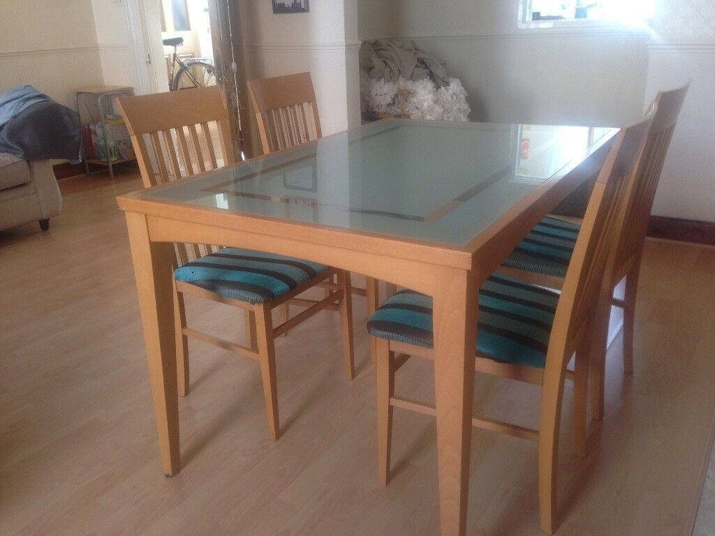 Glass Dining Table With Wooden Border And Legs 4 Chairs