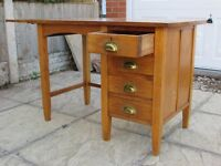 Solid Oak 4 Draw Desk with extention flap in Very Good Used Condition