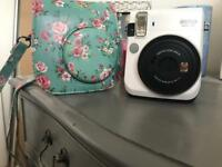 Brand new instax mini 70 pearl white and case.