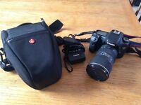 Canon 7d DSLR with Manfrotto bag, Tokina lens, 32gb memory card