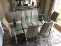 Modern glass table and 6 leather dining chairs - As new condition