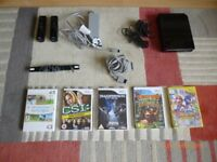 Nintendo Wii Console black with power plug, 2 nunchucks, 2 controllers and 5 games