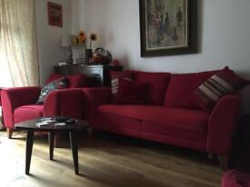 A delightful red, fabric sofa and armchair for sale